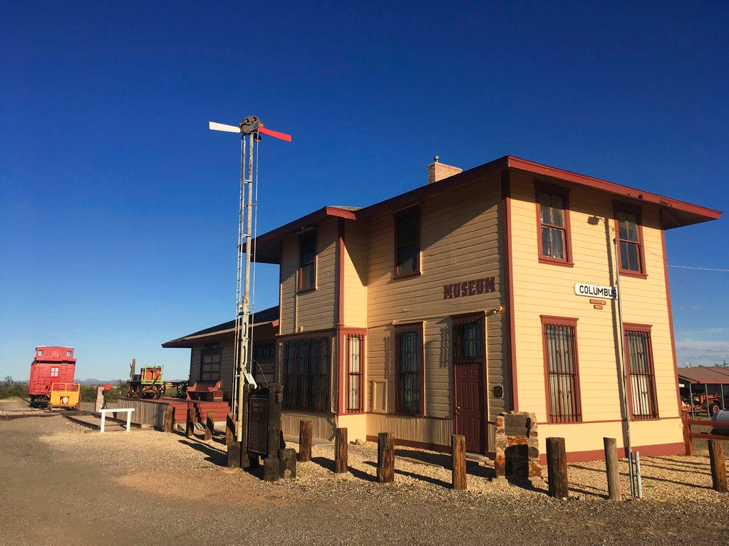 In this Oct. 3, 2018 photo, the historic train station of Columbus, N.M., once attacked by Mexican Revolutionary Pancho Villa is shown before sunset. As Democrats seek to flip a key GOP U.S. House seat in southern New Mexico, the path to victory in districts like those that encompass Columbus includes winning over fiercely independent voters in communities who have their own views about border life.