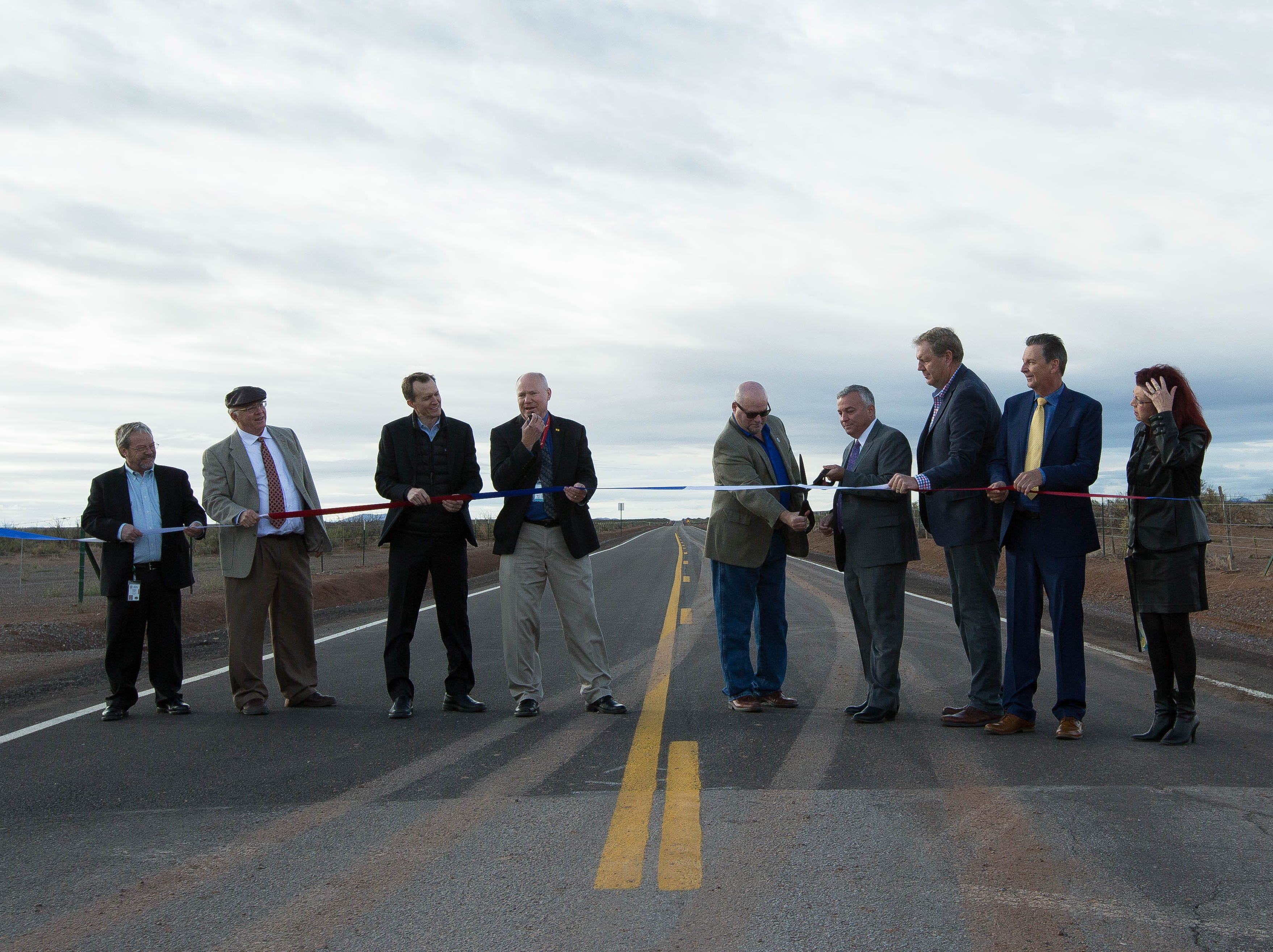 Bruce Swingle, county manager of Sierra County and Chuck McMahon, assistant county manager for Doña Ana County, along with other dignitaries cut the ribbon for the new southern road leading to Spaceport America, Friday October 19, 2018.