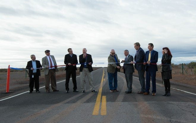 Bruce Swingle, county manager of Sierra County, and Chuck McMahon, assistant county manager for Doña Ana County, along with other dignitaries cut the ribbon for the new southern road leading to Spaceport America, Friday October 19, 2018.
