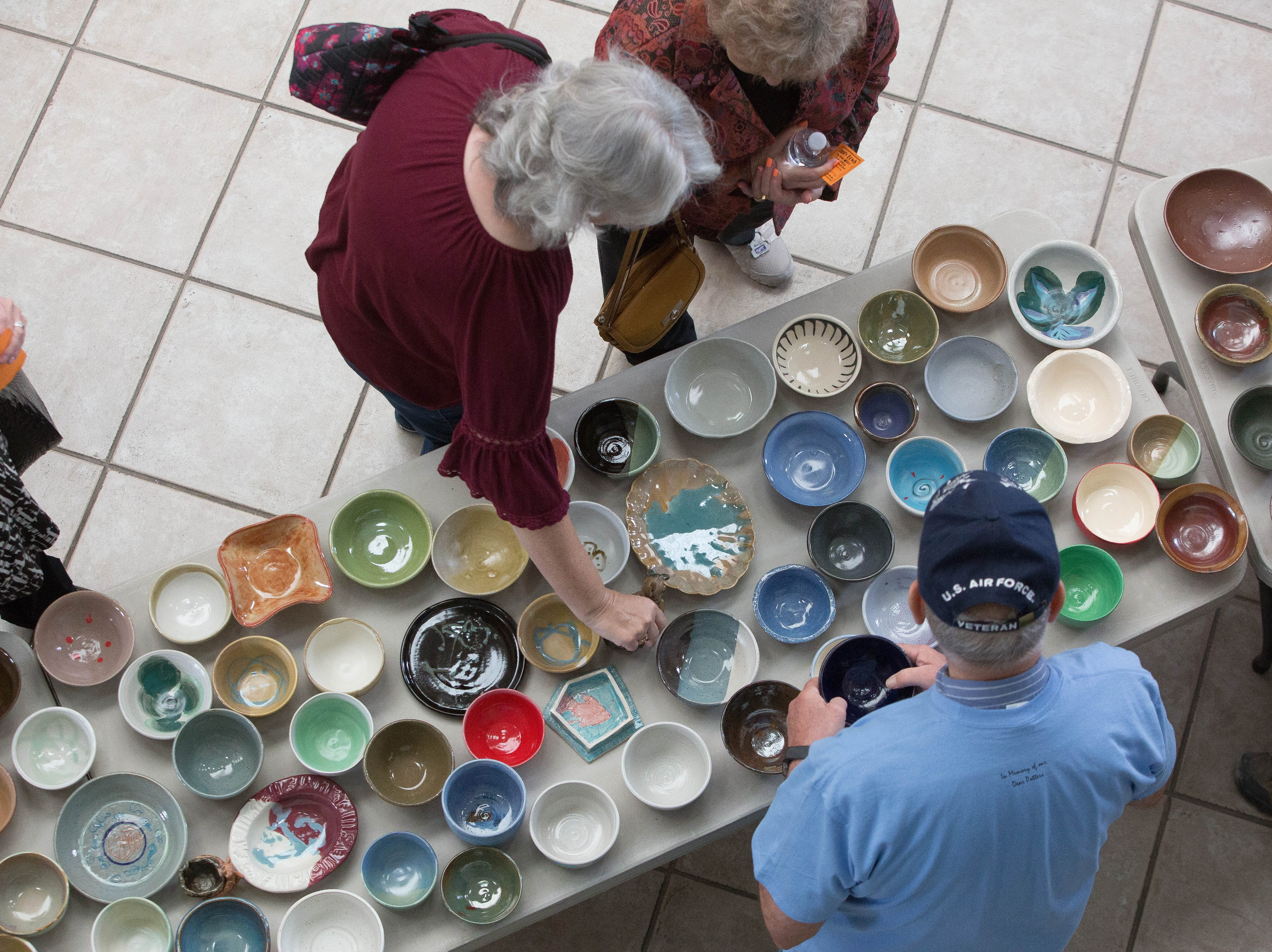 El Caldito Soup Kitchen and the Potters'Guild of Las Cruces, hosted the 26th annual Empty Bowls event at St. Paul's UnitedMethodist Church, Friday October 19, 2018. Las Crucens bought tickets, looked through the multitudes of bowls made by the Potters Guild, and ate soups provided by more than 50 different local restaurants.
