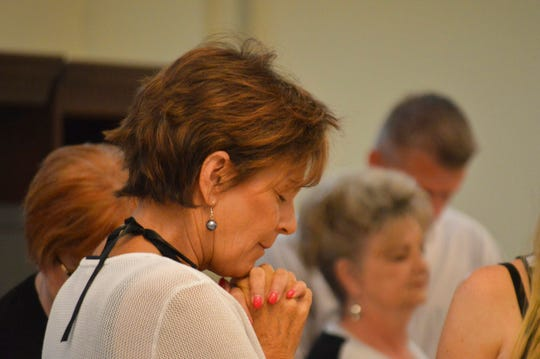 In this May 24, 2018 photo, GOP Congressional hopeful Yvette Herrel for a seat in southern New Mexico prayers before a Republican forum in Hobbs.