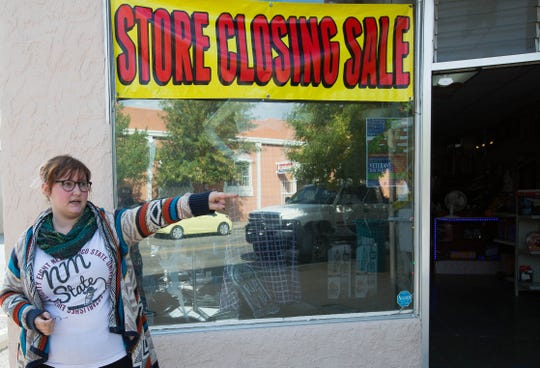 Standing outside her store, Audra Veazey, owner of Audra's Attic, a thrift store on Main Street in downtown Las Cruces, talks about her store closing and the effect she felt  the downtown construction had in the decision to close her store, Friday October 19, 2018.