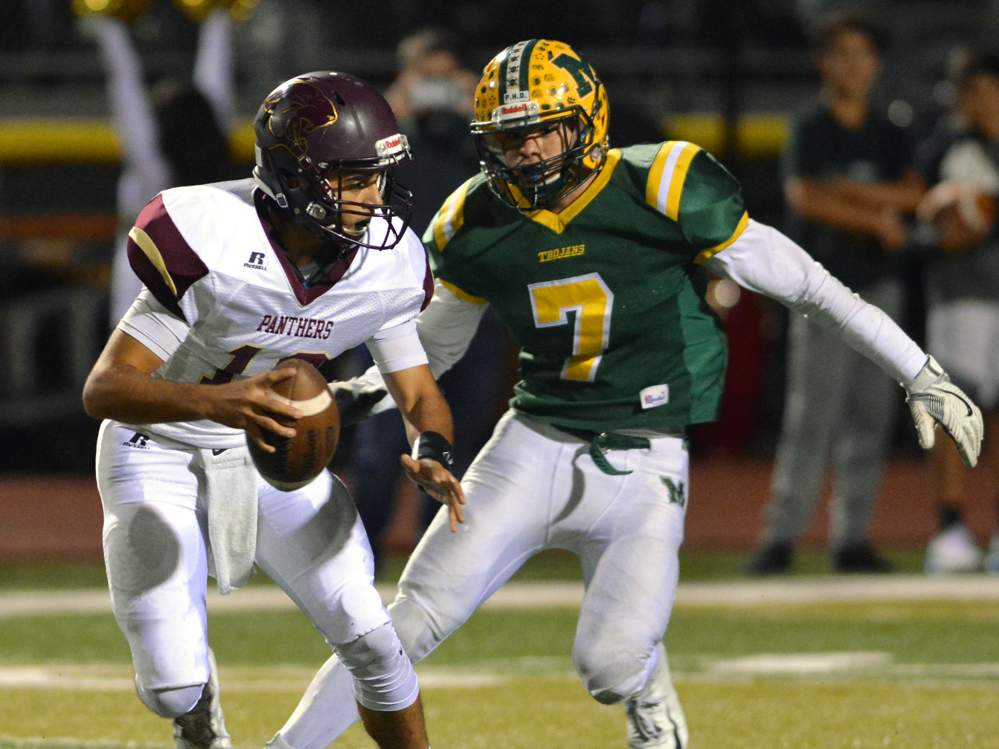 Mayfield defensive end John Martinez (7) has his eye on tackling Gadsden High quarterback Jesse Sanchez for loss on Thursday night at the Field of Dreams.