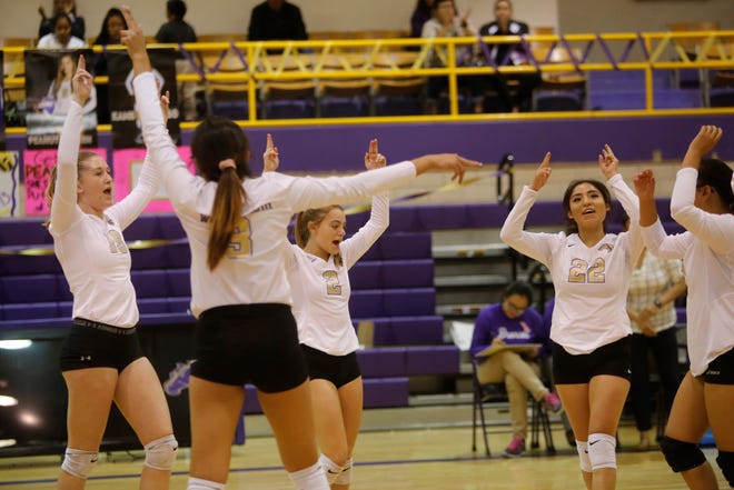 Kirtland Central celebrates its match-clinching point against Gallup during Thursday's District 1-4A match at KCHS. Visit daily-times.com to see the latest sports photo galleries and video highlights.