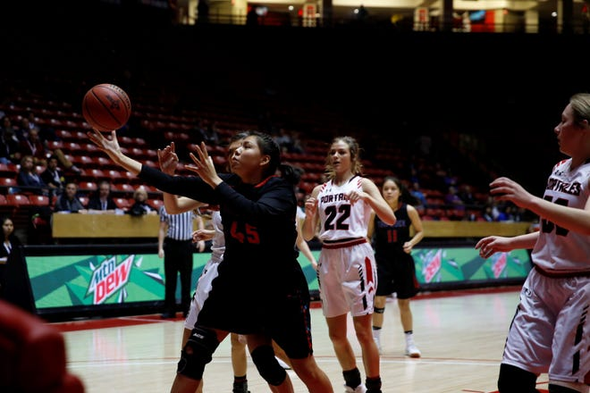 Shiprock's Marie Lynn Lansing regains control of the ball before going to the basket against Portales during the 4A state semifinals on Thursday, March 8, 2018 in Albuquerque. The Lady Chieftains will start the new season on Nov. 29 hosting the Jerry Richardson Memorial tournament.