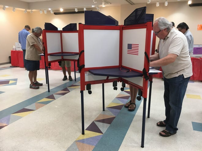 Voters cast ballots at the Farmington Museum at Gateway Park during the primary election on June 2018.