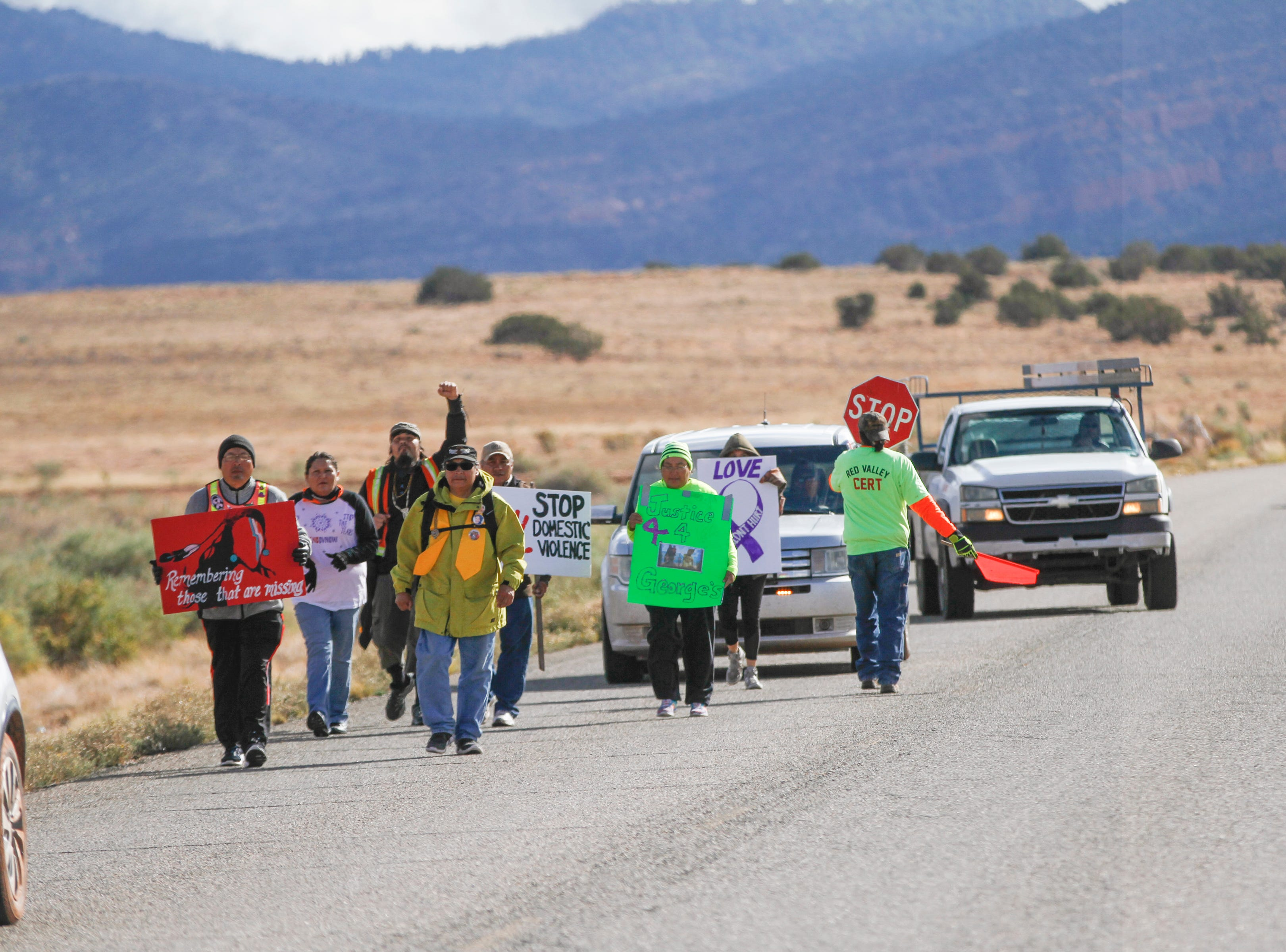 Walking the Healing Path 2018 participants walk along Navajo Route 13 Thursday, Oct. 18, 2018 in Red Valley , Arizona. The walk began on Oct. 13, 2018 in Window Rock, Arizona and they will conclude their route today, Saturday, Oct. 20, 2018 at the Phil L. Thomas Performing Arts Center in Shiprock.