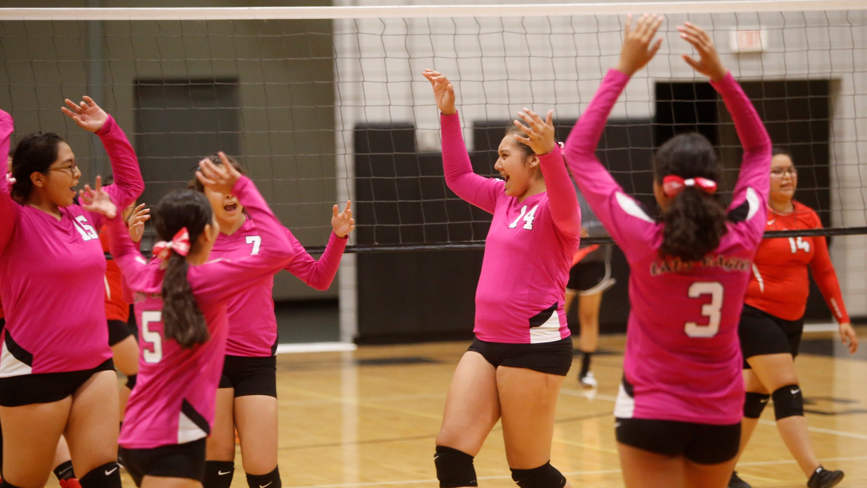 Navajo Prep celebrates a point against Crownpoint during Thursday's District 1-3A match at the Eagles Nest.
