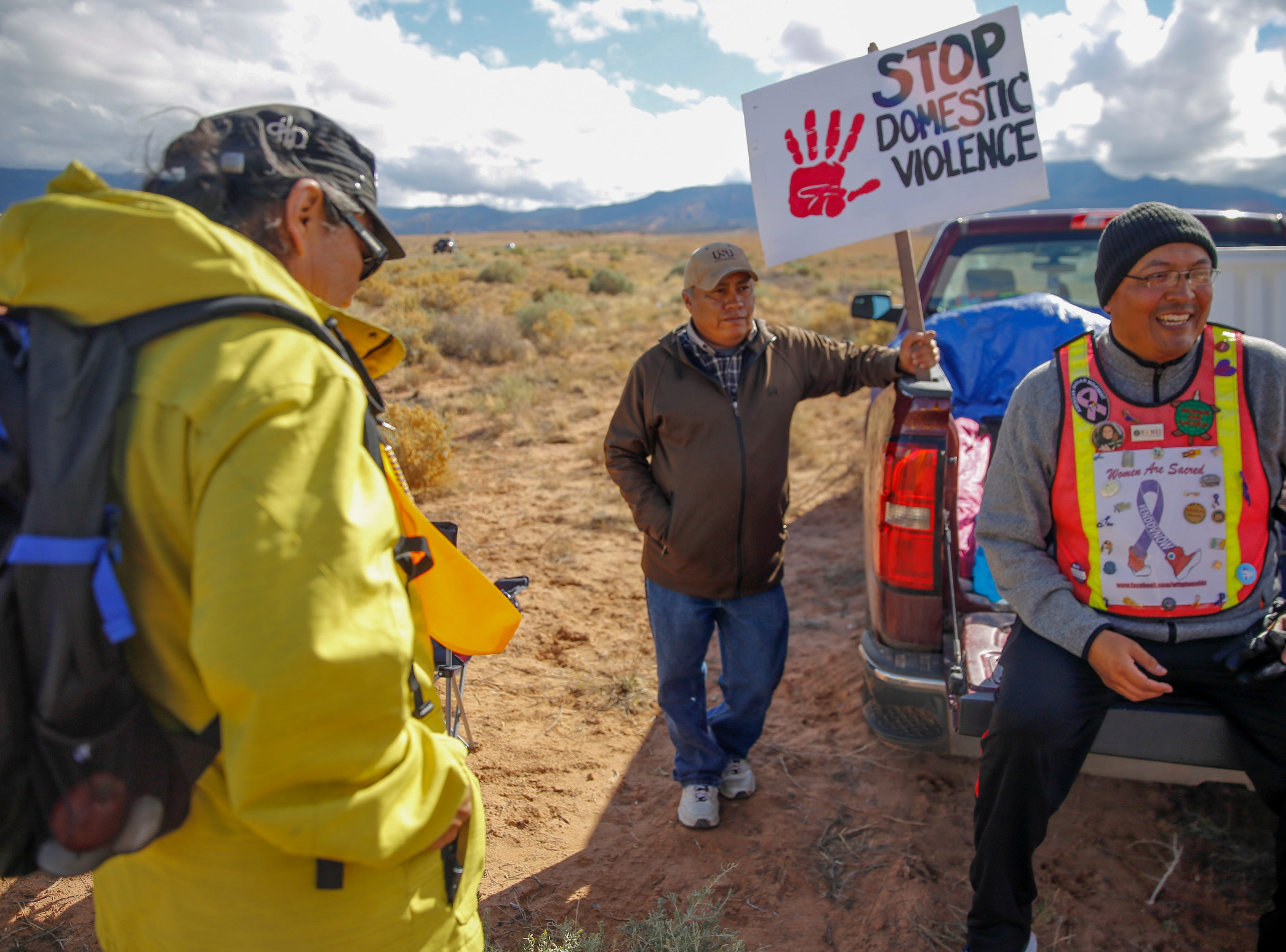 From left, Gary Mike, Jerald Begay and John Tsosie break for lunch along Navajo Route 13 in Red Valley , Arizona, Thursday, Oct. 18, 2018.