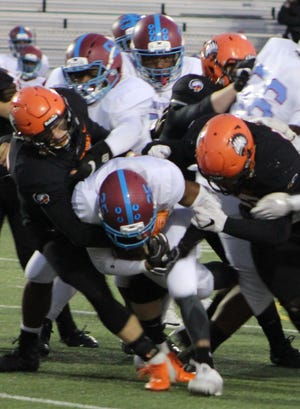 Brother Rice's defense gang tackles a Mumford running back early in Thursday's non-league battle played at Hurley Field in Berkley.