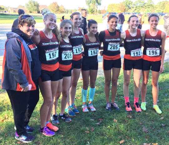 Coach Nancy Smith and her Northville girls cross country team captured their seventh straight KLAA championship.
