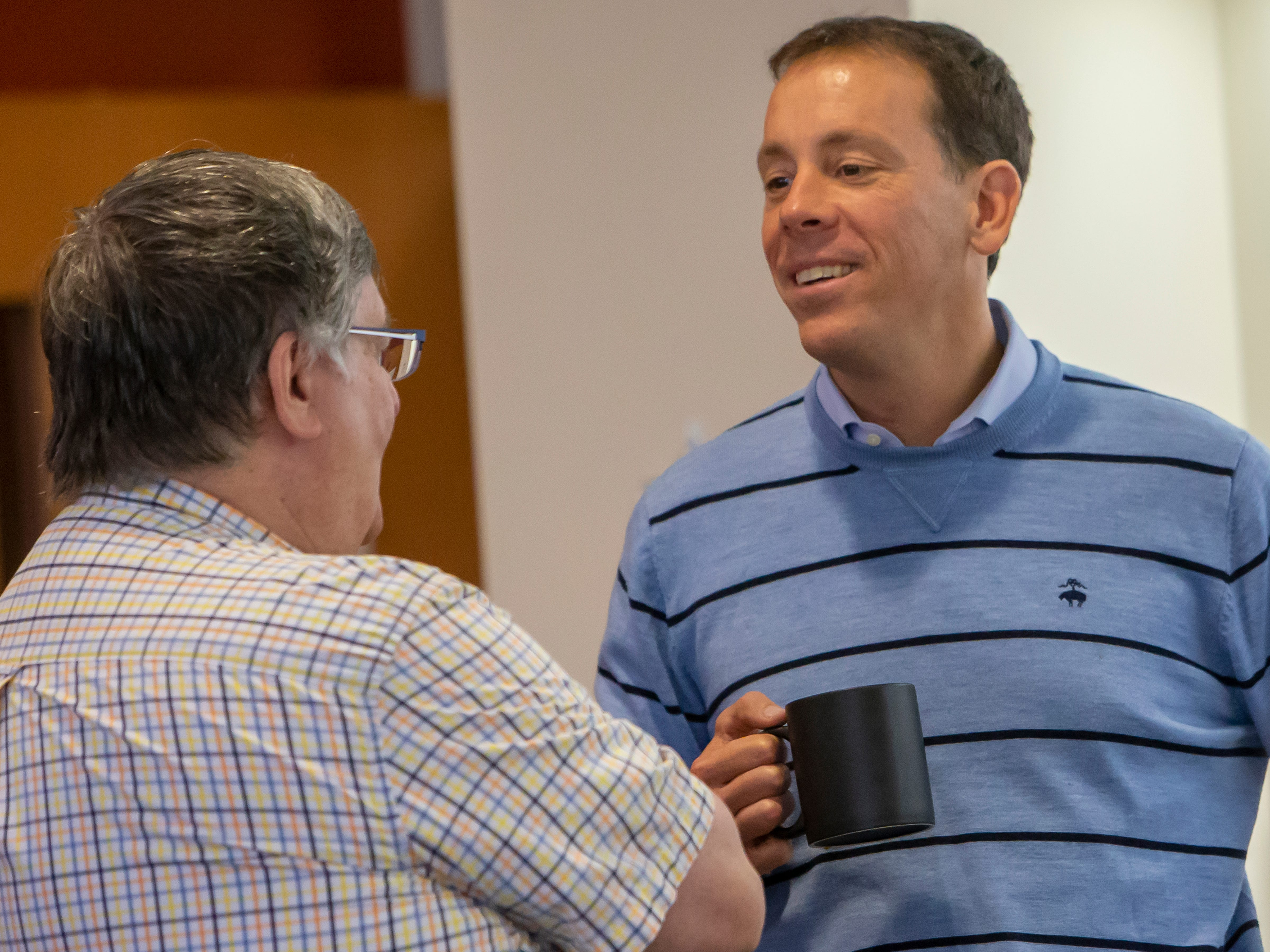 Jim VandeHei, Co-Founder of Politico and Axios, mingles with people as the University of Wisconsin-Oshkosh celebrates fifty-years of journalism during the event held at Sage Hall on Friday, October 19, 2018.