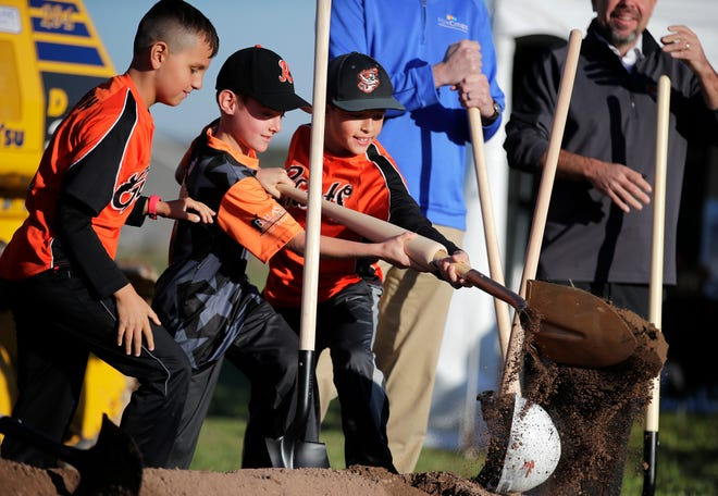 Adam Johnson, 9, Brayden Jenkins, 9, and Alec Hietpas, 10, all members of Kaukauna Youth Baseball, help break ground at the future site of Unison Field on Thursday in Harrison.