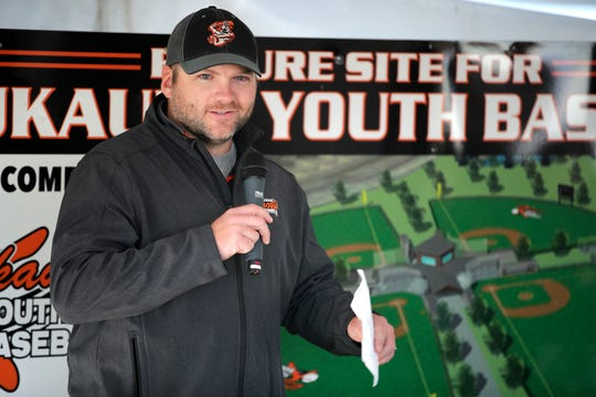 Corey Schuh, Kaukauna Youth Baseball president, talks about the status of Unison Field before the groundbreaking event Thursday.