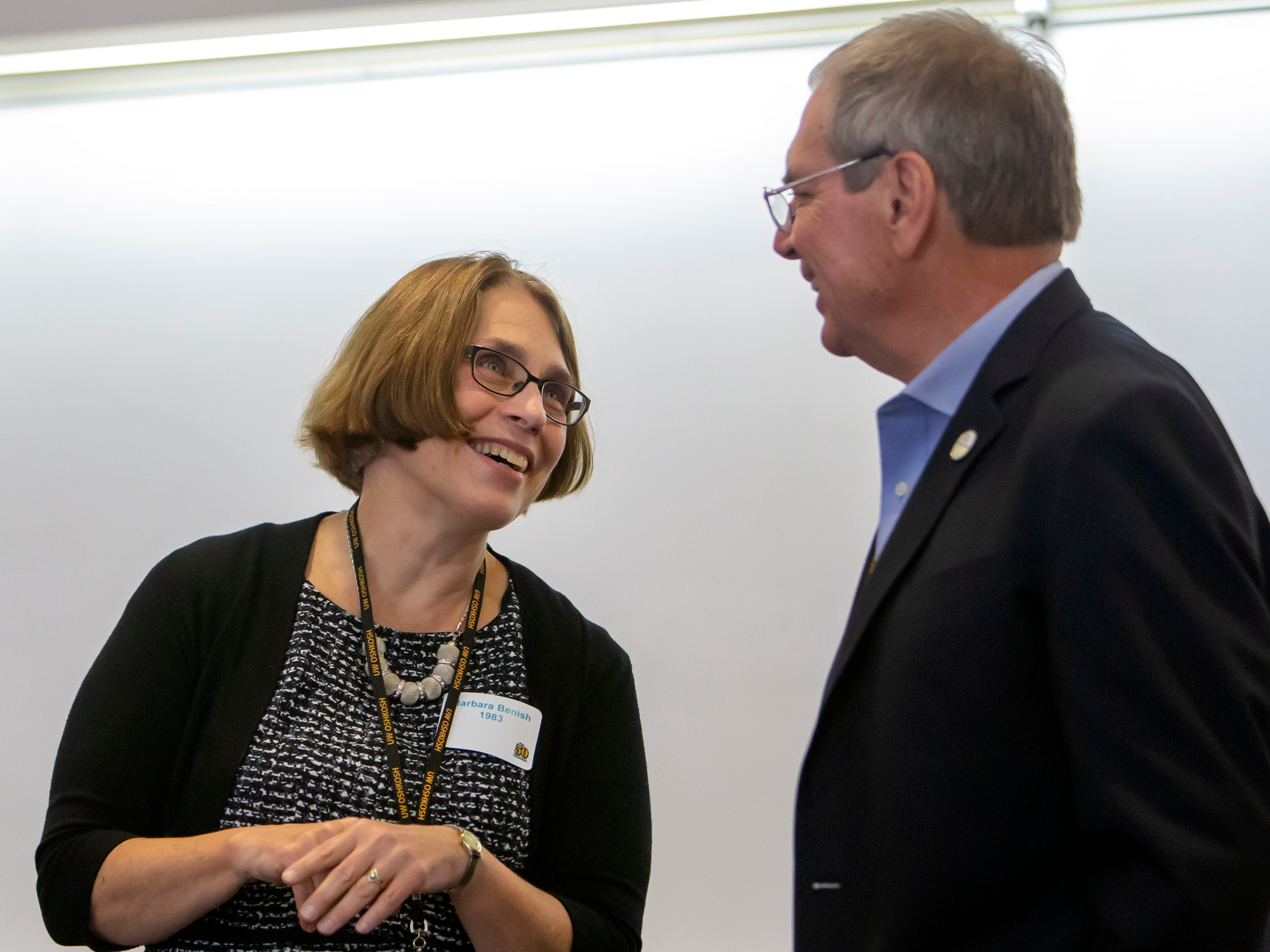 Barb Benish, UW-Oshkosh instructor and freelance writer, and Paul Anger, Retired Editor and Publisher, Detroit Free Press, converse before the panel discussion at the University of Wisconsin-Oshkosh Sage Hall as the school celebrates fifty-years in journalism on Friday, October 19, 2018.