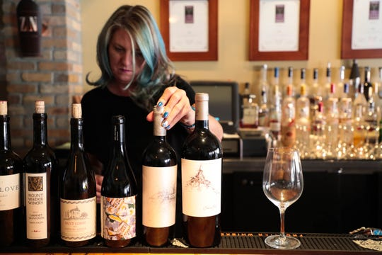 Mindy Reed, owner of Zin American Bistro, works behind her bar Thursday, October 18, 2018 in Palm Springs, Calif.