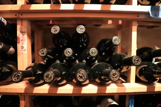Wine sits on the shelves in the wine seller of Zin American Bistro on Thursday, October 18, 2018 in Palm Springs, Calif.