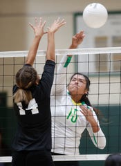 Coachella Valley High School's Cheyenne Sandoval spikes the ball for a point against San Jacinto Valley Academy. Coachella Valley won the game playoff game in Thermal, California