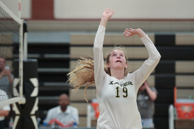 Xavier Prep's Sophia Callahan sets the ball in a match against Valley Christian, Thursday, October 18, 2018. Xavier Prep won the match with a 3-1 victory.