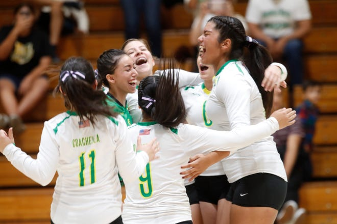 Coachella Valley High School's celebrate winning against San Jacinto Valley Academy during their CIF playoff game in Thermal, California.