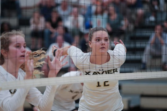 Xavier Prep's Taylor Schein defends the net against Valley Christian, Thursday, October 18, 2018. Xavier Prep won the match with a 3-1 victory.