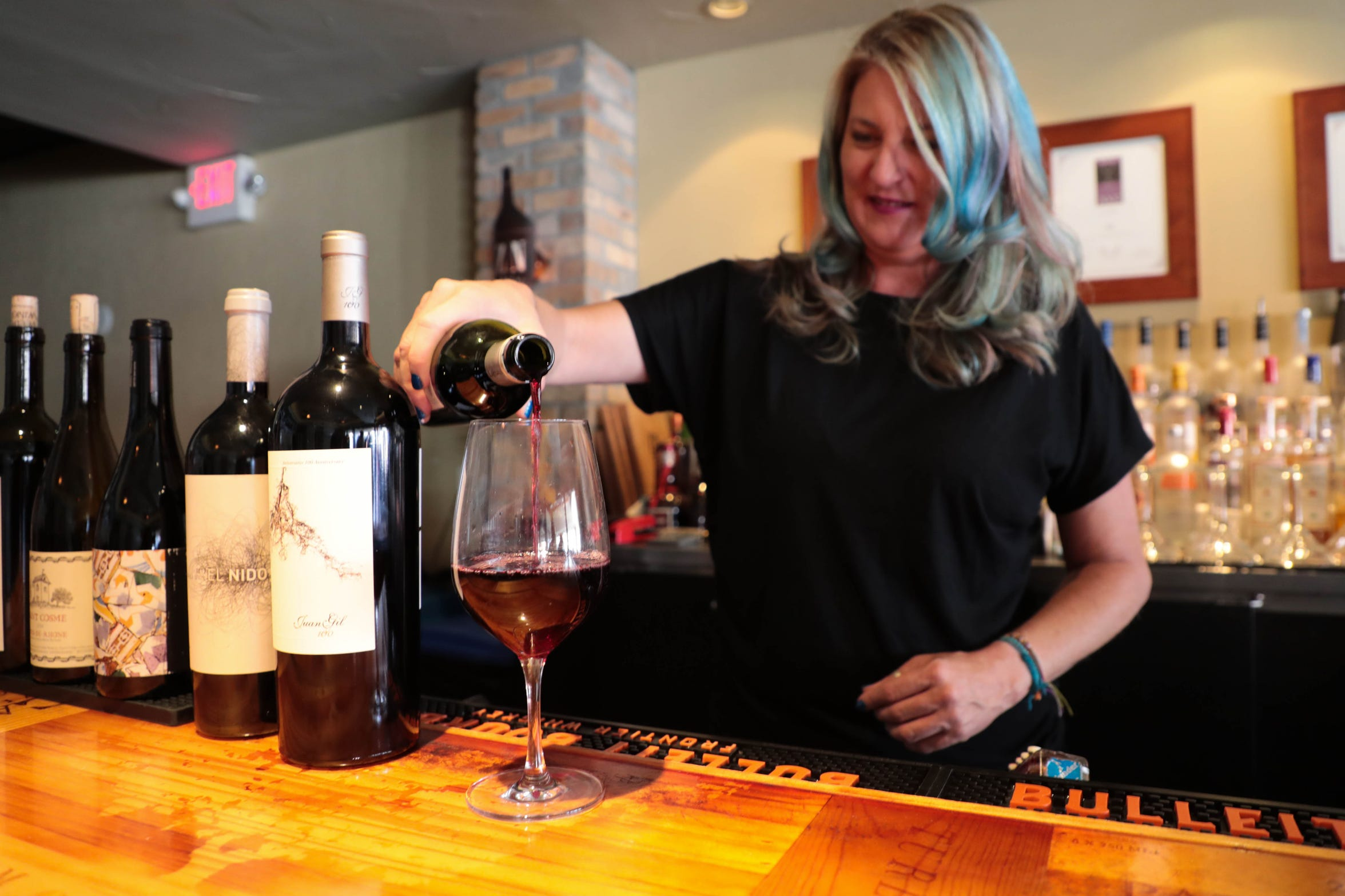 Mindy Reed, owner of Zin American Bistro, pours wine on Thursday, October 18, 2018 in Palm Springs, Calif.