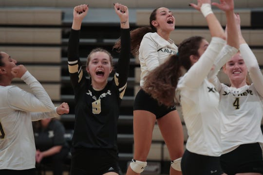 Xavier Prep players celebrates after a point against Valley Christian, Thursday, October 18, 2018. Xavier Prep won the match with a 3-1 victory.