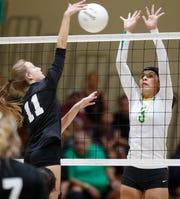 Coachella Valley High School's Valeria Astorga blocks against San Jacinto Valley Academy during their CIF playoff game in Thermal, California. Coachella won the game.