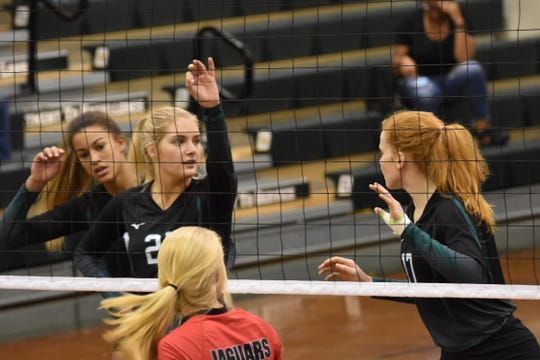 Catholic senior Molley Majewski speaks with teammate Hannah Meyers (17) prior to a set play in Thursday night's District 1-5A Tournament against West Florida.
