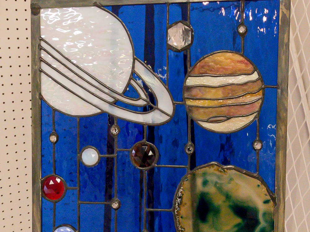 """Majestic Solar System,"" a 22""x19"" stained glass piece by Sandra Neto, is among over one hundred pieces on display in the Fine Arts Exhibition at the Pensacola Interstate Fair on Wednesday, October 17, 2018."