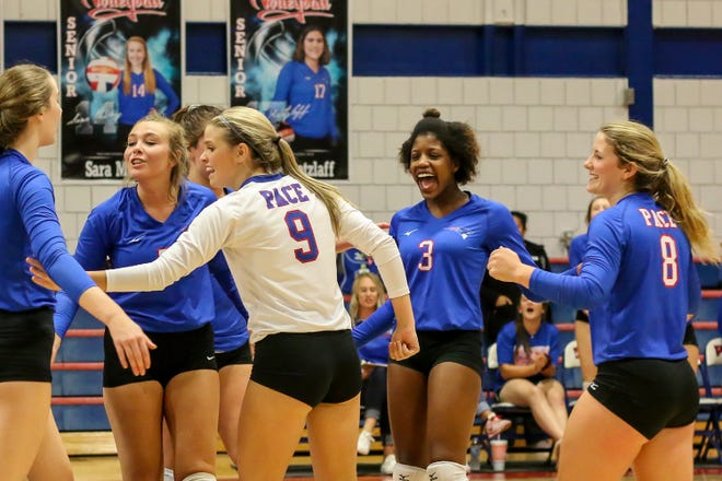 Pace celebrates a point against Washington in the District 1-7A championship game at Pace High School on Thursday, October 18, 2018. The Patriots beat the Wildcats in three straight sets and earned their second district title in a row.