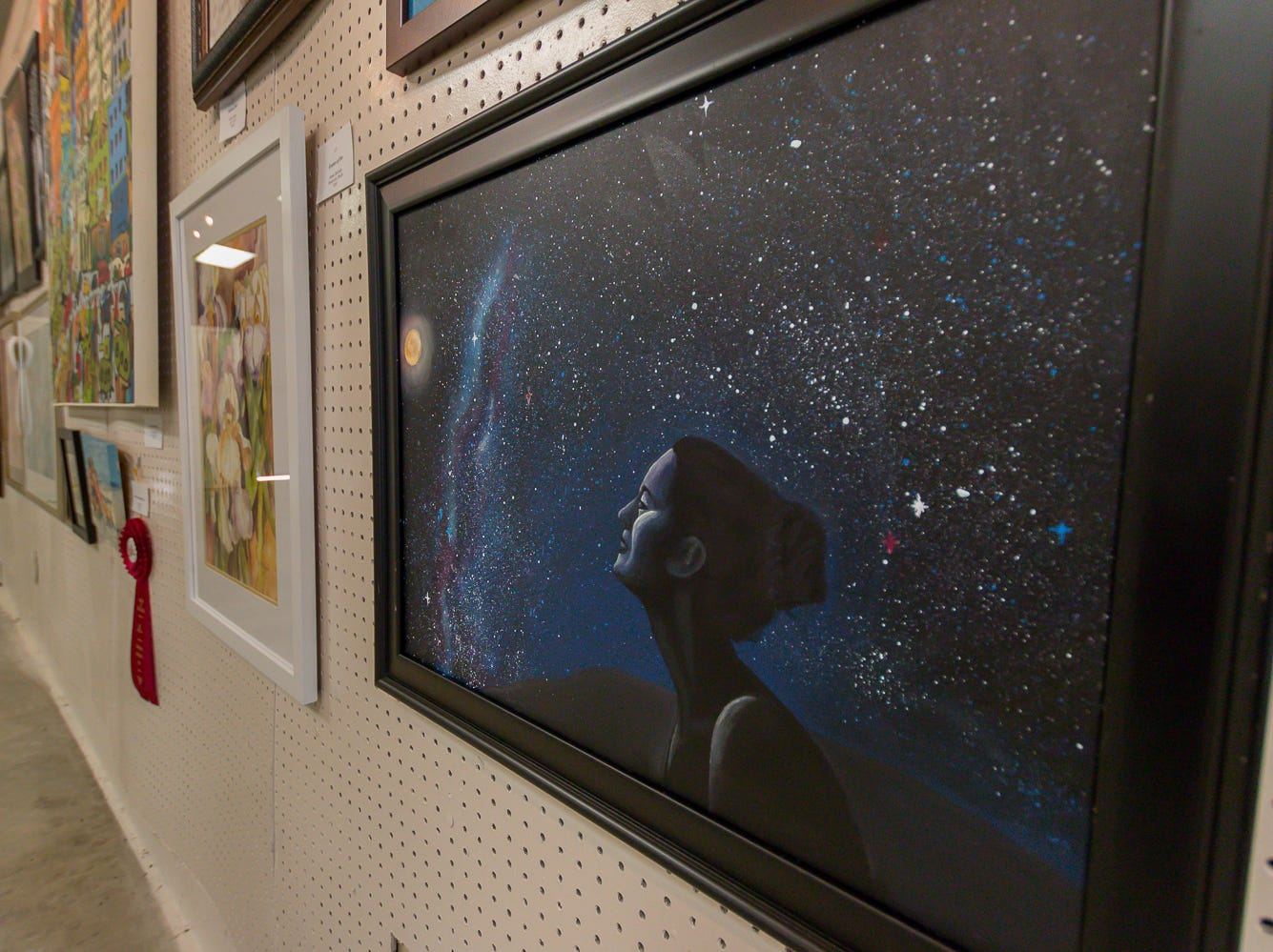 """Milky Way Maiden,"" an 18""x24"" mixed media piece by Elizabeth Grace Olsen, is among over one hundred pieces on display in the Fine Arts Exhibition at the Pensacola Interstate Fair on Wednesday, October 17, 2018."
