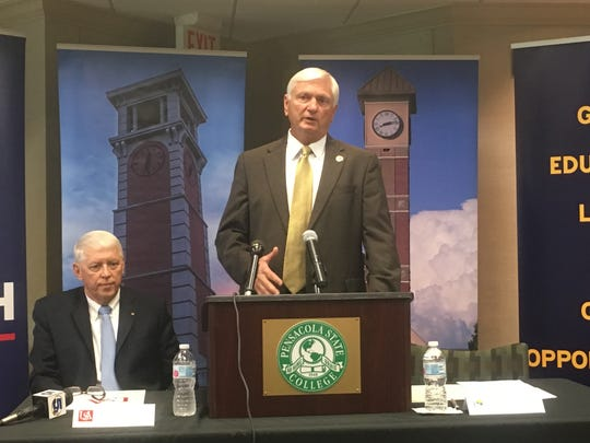 Pensacola State College President Ed Meadows, center, talks about the 'Pathway USA' articulation agreement Friday beside University of South Alabama President Tony Waldrop at the PSC campus.