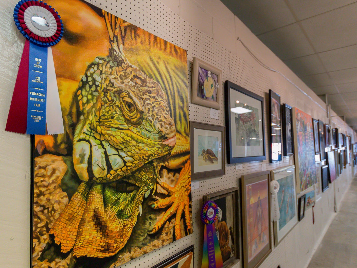 "Freddy Myers won Best of Show with ""Iguana,"" a 30""x40"" acrylic painting that is among over one hundred pieces on display in the Fine Arts Exhibition at the Pensacola Interstate Fair on Wednesday, October 17, 2018."