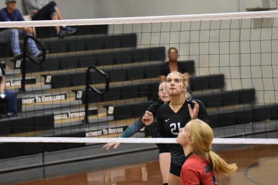 Catholic senior Molley Majewski gets set to return set up a play during Thursday night's District 1-5A Tournament semifinal against West Florida