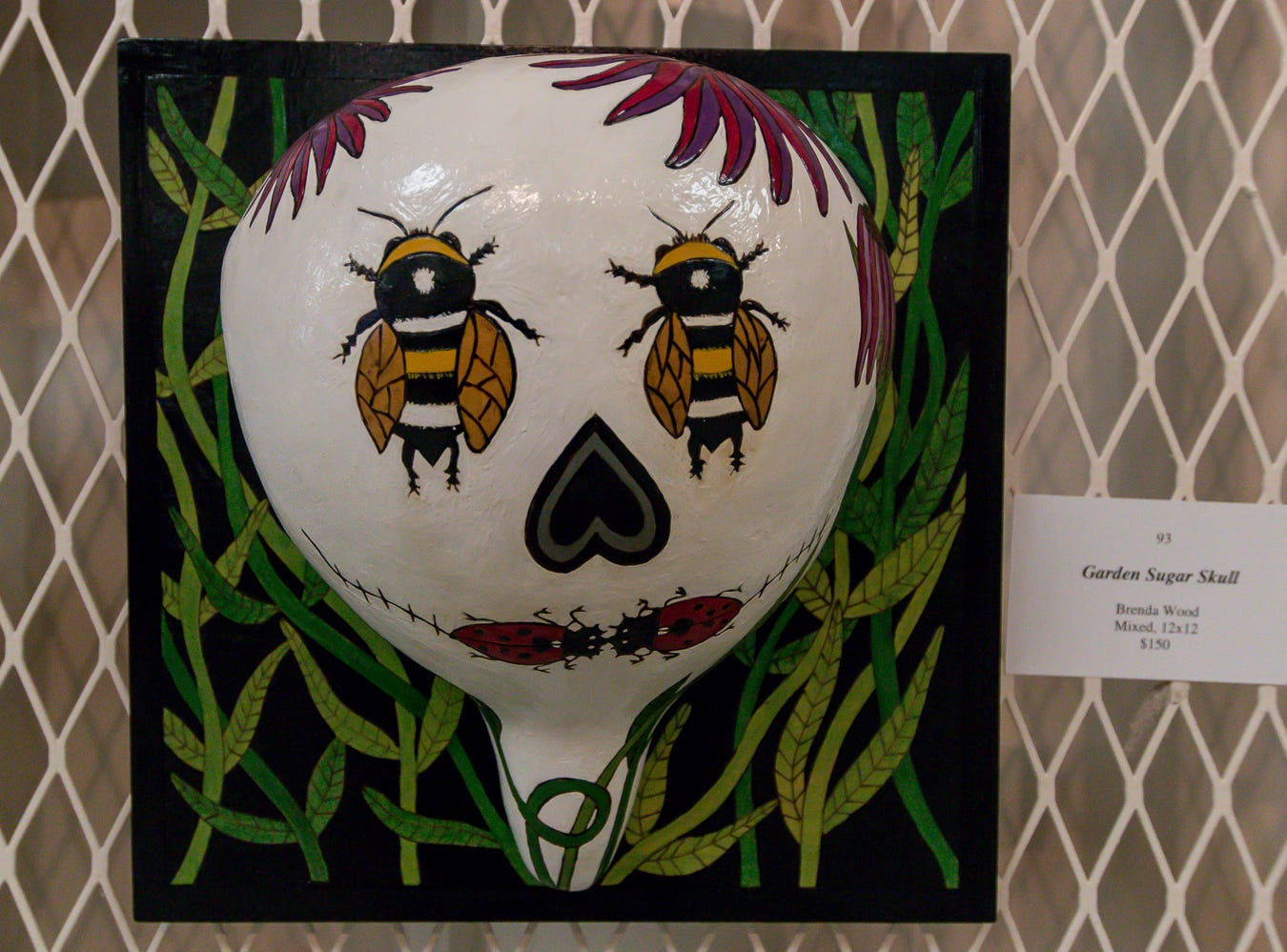 """Garden Sugar Skull,"" a 12""x12"" mixed media piece by Brenda Wood, is among over one hundred pieces on display in the Fine Arts Exhibition at the Pensacola Interstate Fair on Wednesday, October 17, 2018."