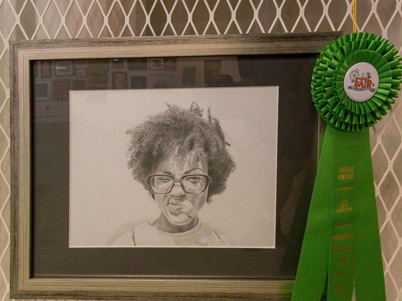 "Crystal Partridge won the Judges Award with ""Grace,"" a 16""x20"" graphite drawing, that is among over one hundred pieces on display in the Fine Arts Exhibition at the Pensacola Interstate Fair on Wednesday, October 17, 2018."