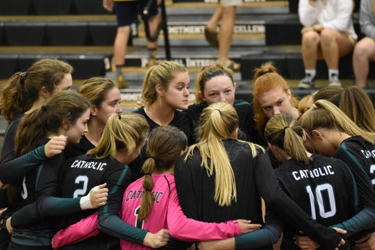 Catholic volleyball team gathers before game in Thursday's District 1-5A Tournament semifinal against West Florida