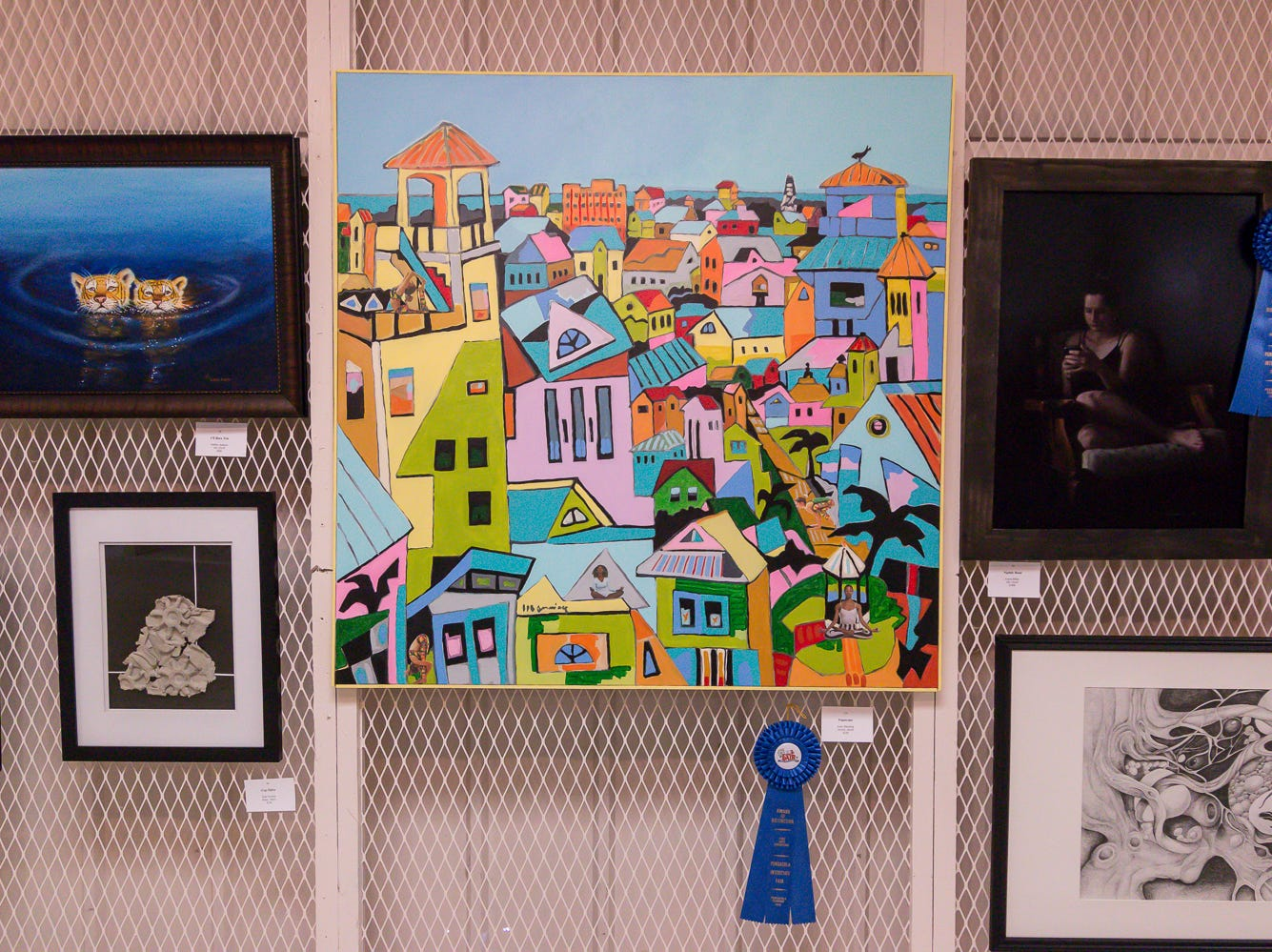 Some of the over 100 pieces of art on display in the Fine Arts Exhibition at the Pensacola Interstate Fair on Wednesday, October 17, 2018.