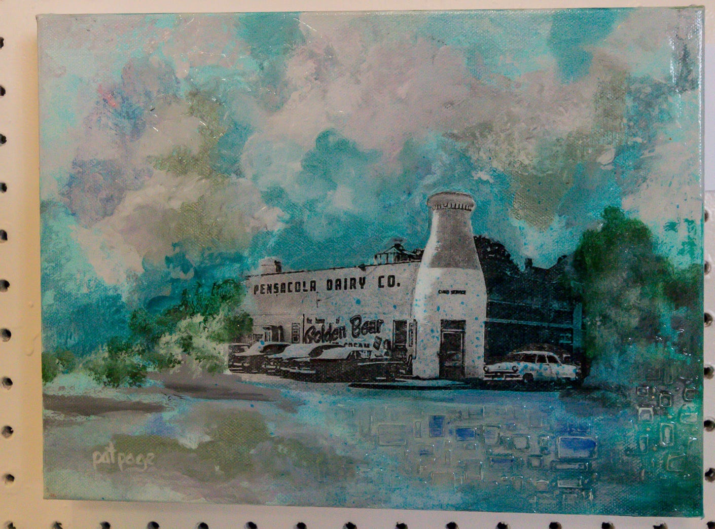 """Pensacola Dairy,"" a 9""x12"" mixed media piece by Pat Page, is among over one hundred pieces on display in the Fine Arts Exhibition at the Pensacola Interstate Fair on Wednesday, October 17, 2018."