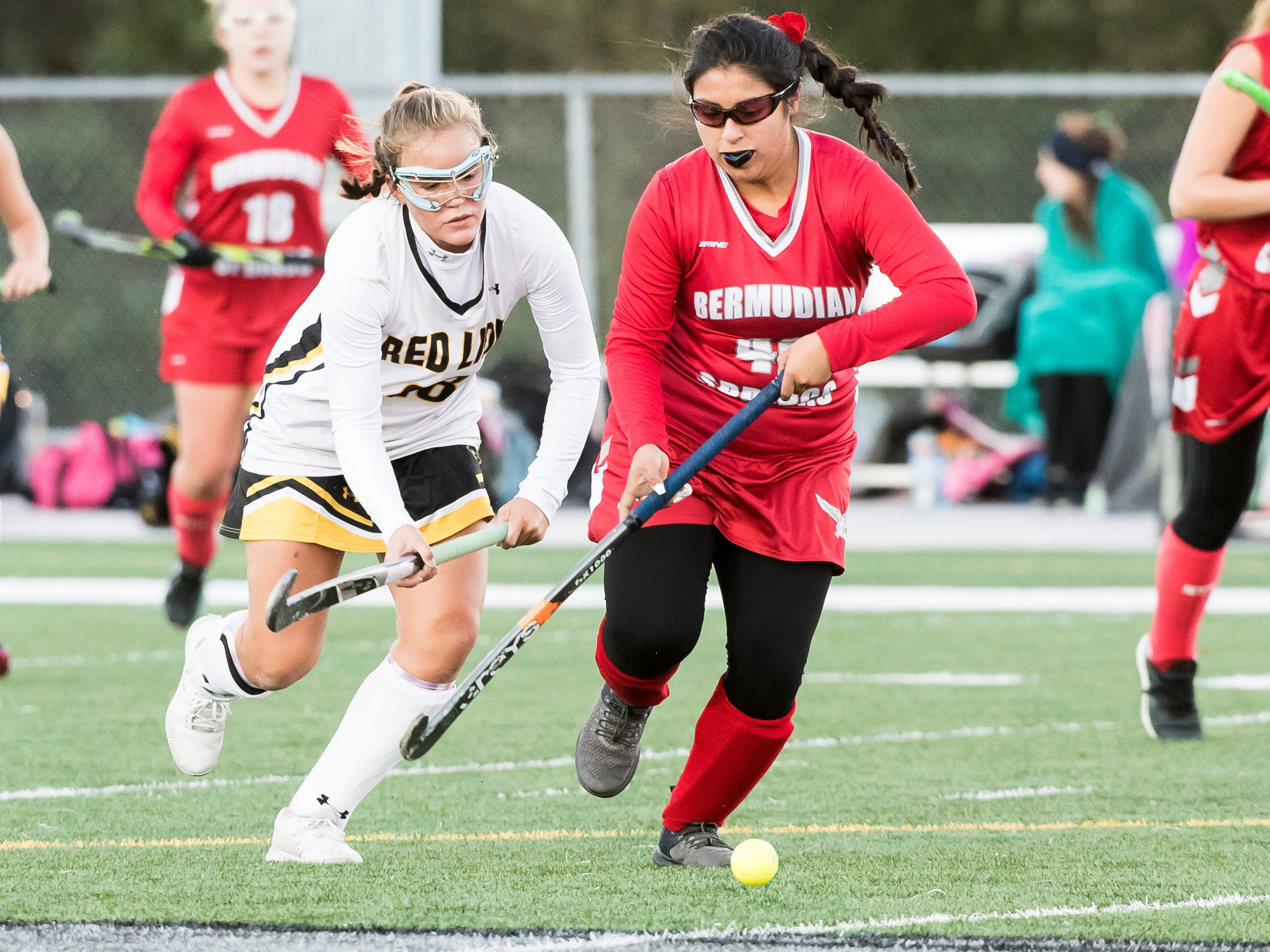 Red Lion's Coda Fisher and Bermudian Springs' Cindy Rivera chase after the ball during a YAIAA tournament semifinal game on Thursday, October 18, 2018. The Lady Lions fell 2-0.