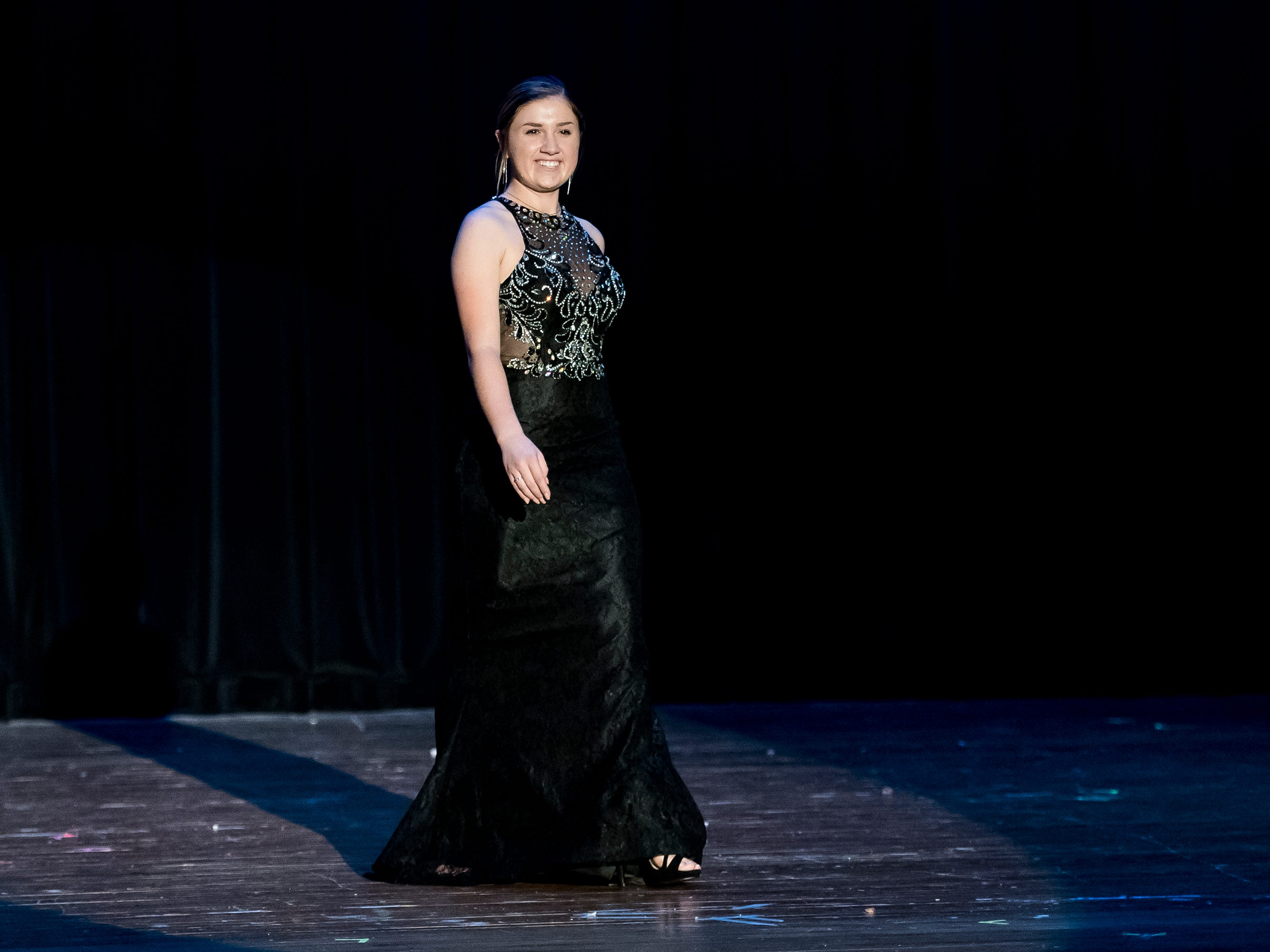 Spring Grove's Hannah Nell walks on stage in her evening gown during a rehearsal session for the Miss Hanover Area pageant at New Oxford High School on Oct. 17, 2018.