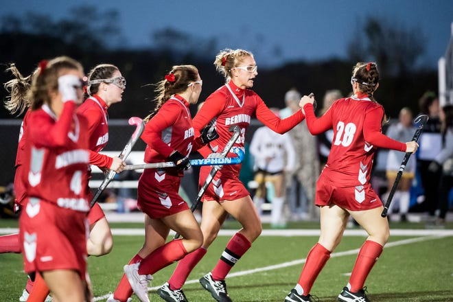 Bermudian Springs' Kayla Pyles fist bumps teammate Alyssa Black (28) after the Eagles scored a goal against Red Lion in a YAIAA semifinal game on Thursday, October 18, 2018. The Eagles won 2-0.