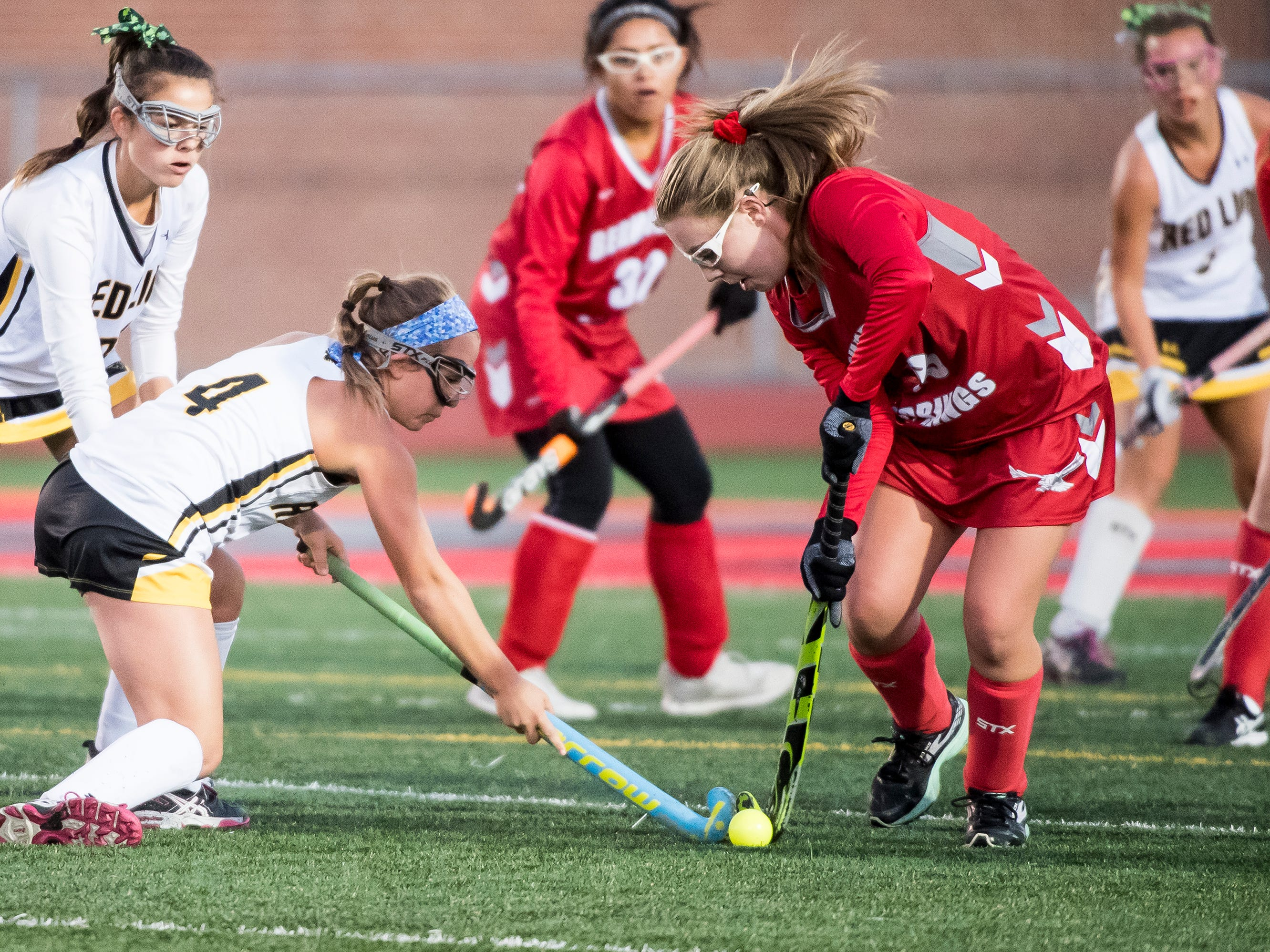 Bermudian Springs' Grace Metzger works around Red Lion's Emma Waltemyer during a YAIAA tournament semifinal game on Thursday, October 18, 2018. The Eagles won 2-0 and will play Central York in the championship game Saturday.