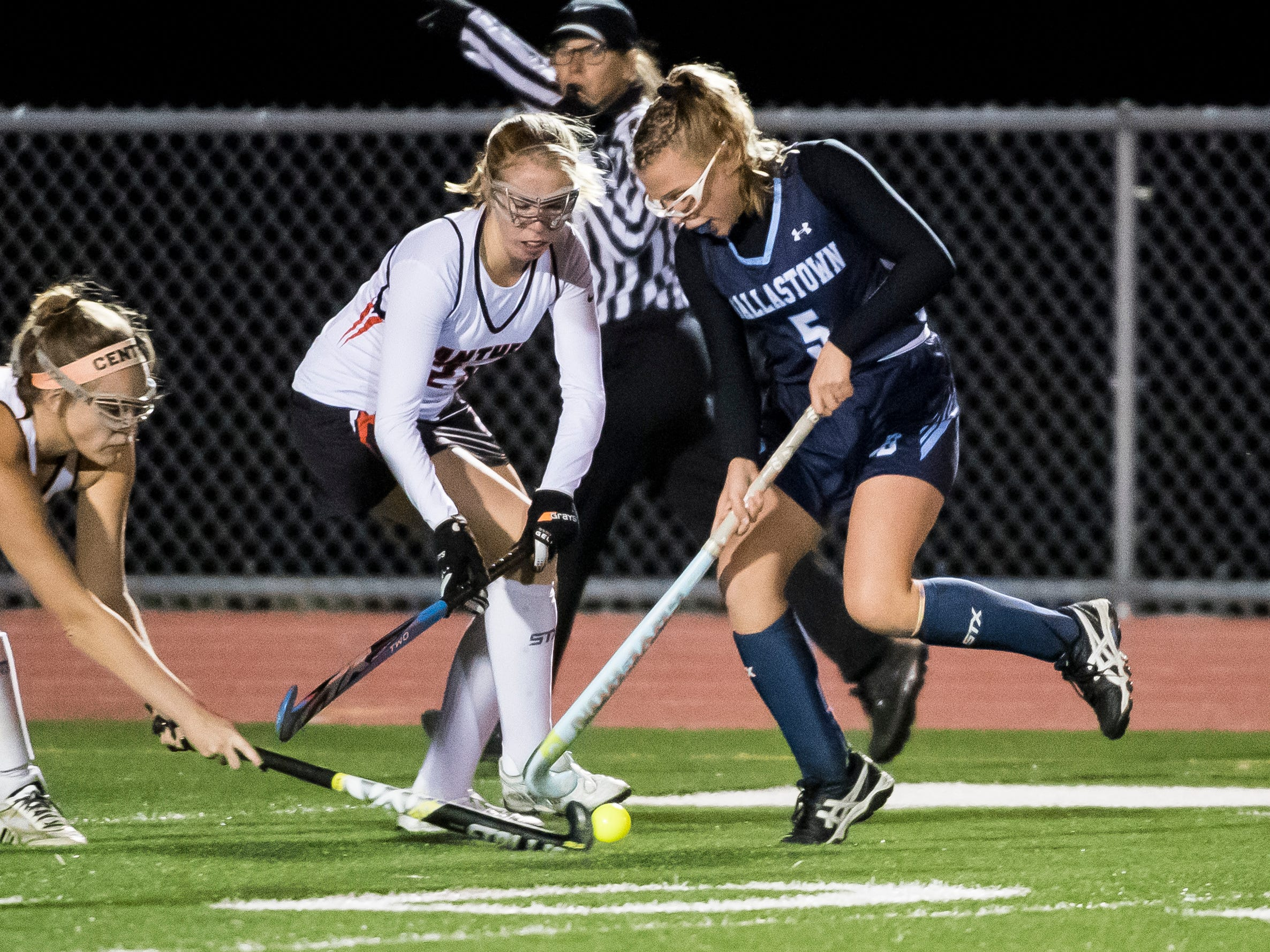 Dallastown's Lily Cantabene (5) fights for the ball with two Central York players Action during a YAIAA tournament semifinal game on Thursday, October 18, 2018. The Panthers won 2-0 and advance to the championship game against Bermudian Springs on Saturday.