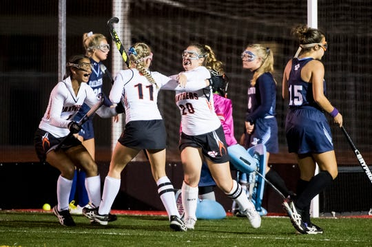 Central York's Kaitlyn Merritt (20) celebrates wither her teammates after scoring a goal against Dallastown in a YAIAA tournament semifinal game on Thursday, October 18, 2018. The Panthers won 2-0 and advance to the championship game against Bermudian Springs on Saturday.