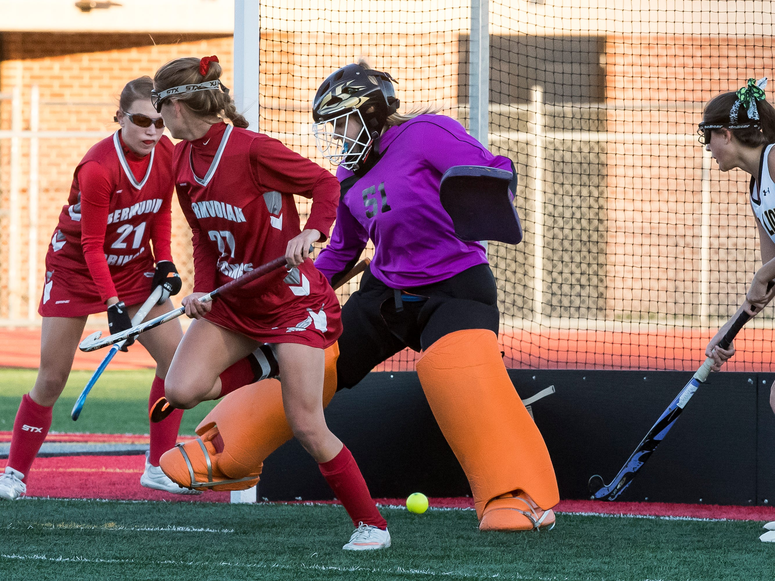 A shot from Bermudian Springs' Kaitlyn McCollum (27) goes between Red Lion's Allie Anderson for a goal during a YAIAA tournament semifinal game on Thursday, October 18, 2018. The Eagles won 2-0.