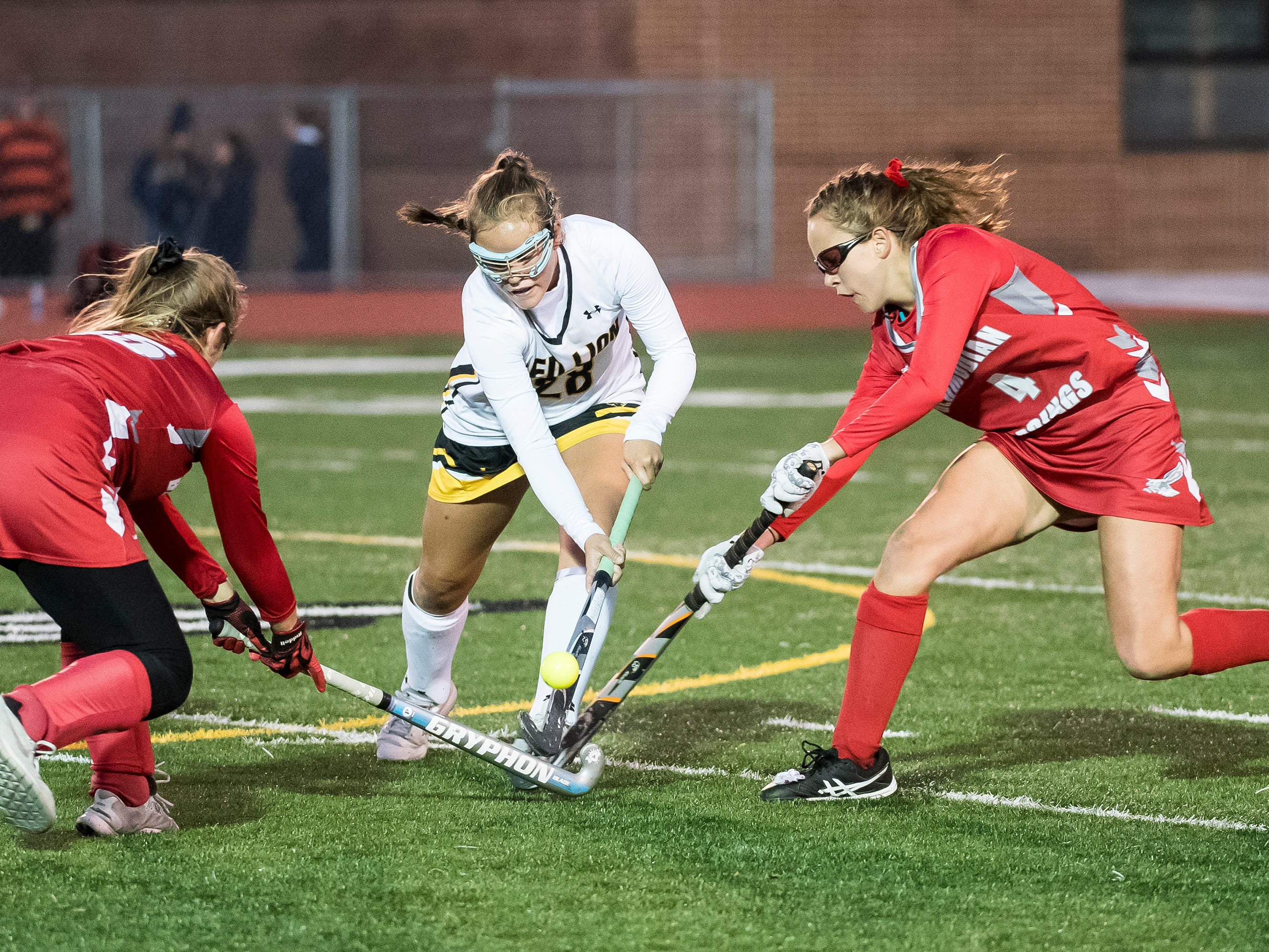 Red Lion's Coda Fisher, center, fights for possession with Bermudian Springs's Skyler West (4) and Hailey Lamo during a YAIAA tournament semifinal game on Thursday, October 18, 2018. The Lady Lions fell 2-0.