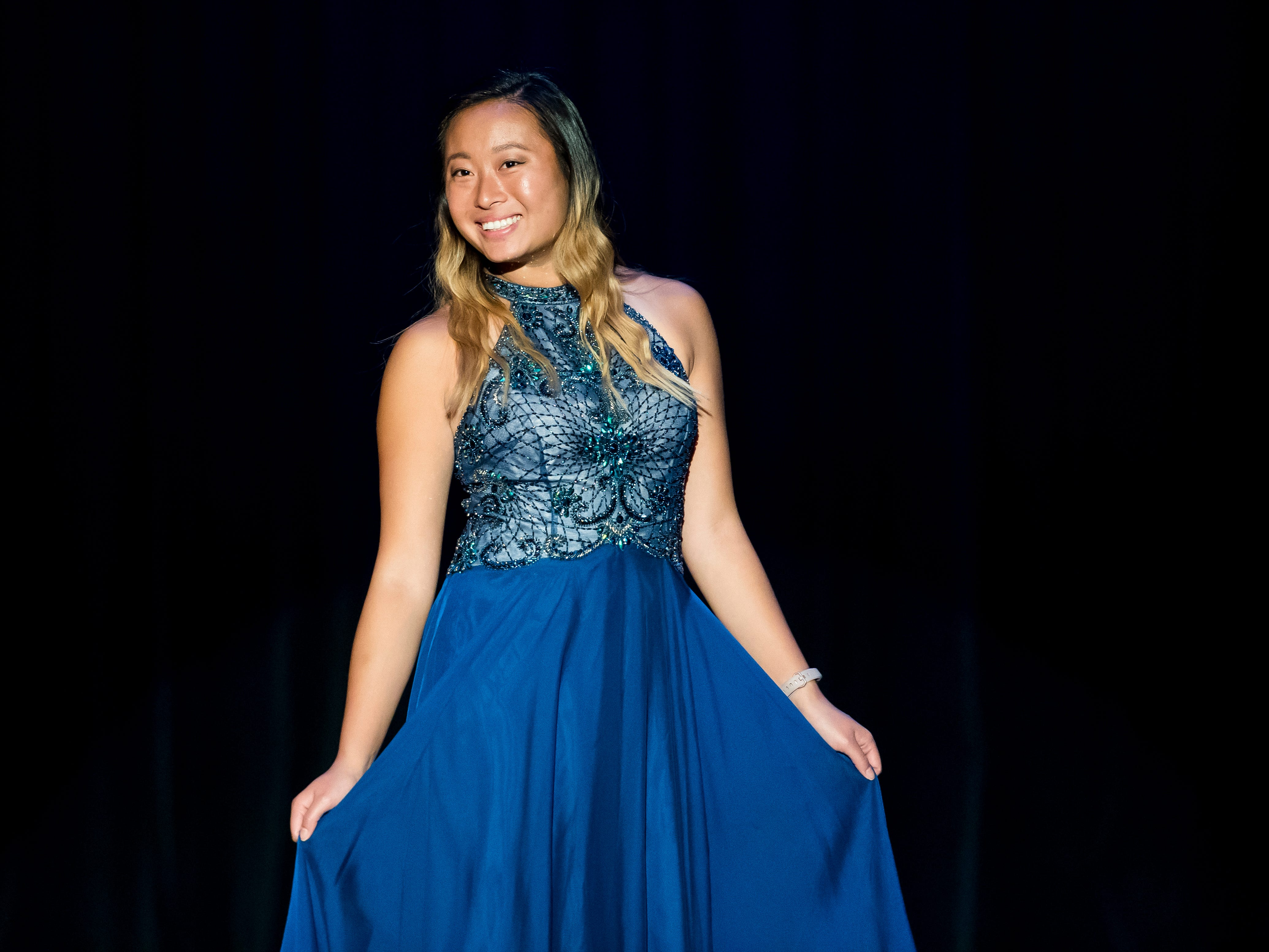 South Western's Karen Yang walks on stage in her evening gown during a rehearsal session for the Miss Hanover Area pageant at New Oxford High School on Oct. 17, 2018.