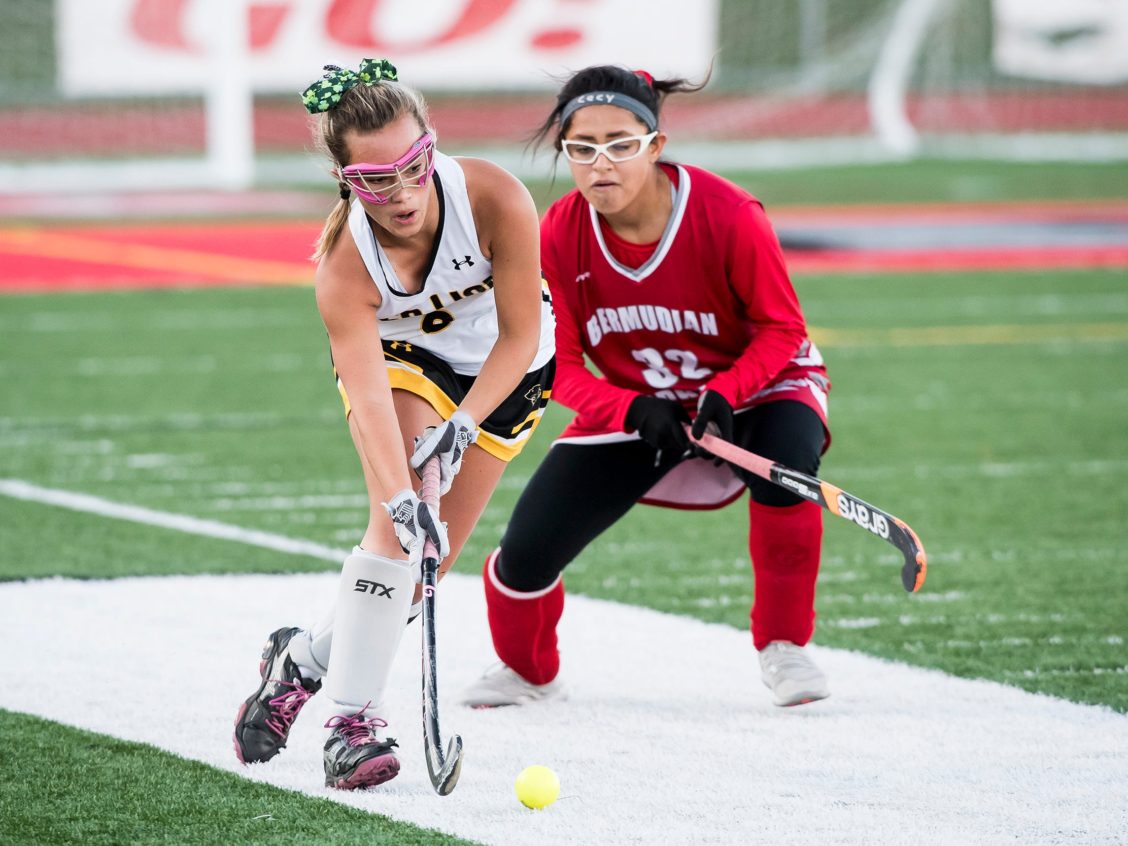 Red Lion's Jillian Sleeth works around Bermudian Springs' Cecy Lua during a YAIAA tournament semifinal game on Thursday, October 18, 2018. The Lady Lions fell 2-0.